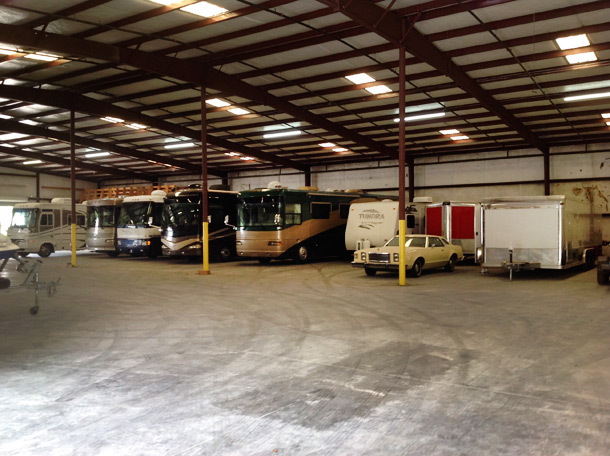 We also have a large area secured with slots available for outdoor and covered outdoor storage. & RV and LARGE ITEM STORAGE
